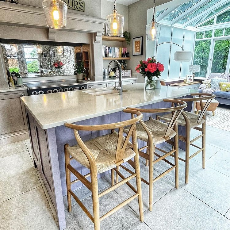 Check out our Wishbone Bar Stools in the kitchen area!