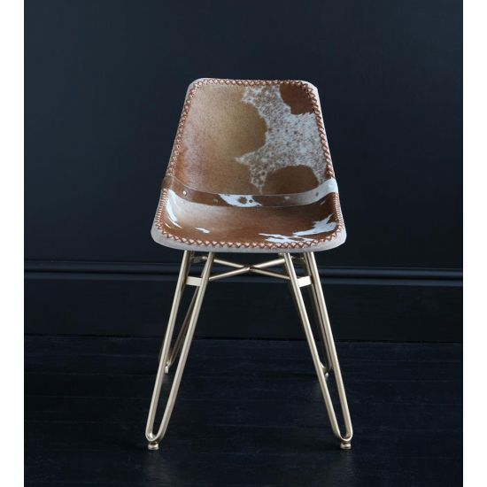 HAIRPIN DINING CHAIR WITH BROWN AND WHITE COW HIDE ROAD HOUSE SEAT AND GOLD BASE