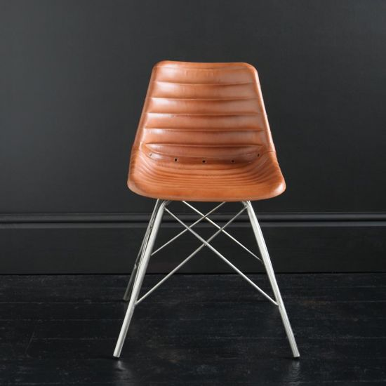 ROAD HOUSE CHAIR WITH TAN RIBBED SEAT AND NICKEL CROSS LEG