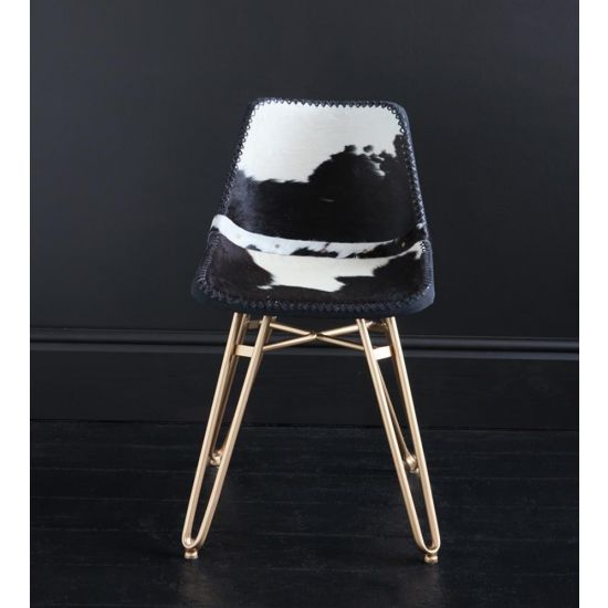 HAIRPIN DINING CHAIR WITH BLACK AND WHITE COW HIDE ROAD HOUSE SEAT AND GOLD BASE