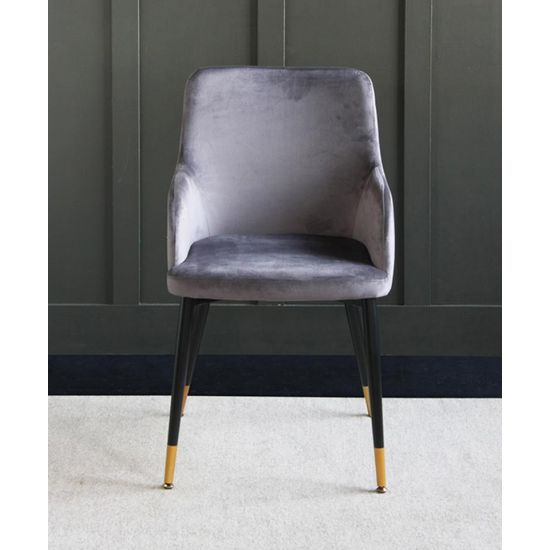 The Grand Grey velvet upholstered dining chair with Pencil leg and raised sides