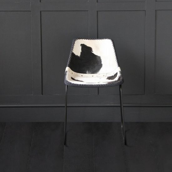 DELUXE ROAD HOUSE DINING CHAIR, BLACK & WHITE COW HIDE SEAT – BLACK BASE