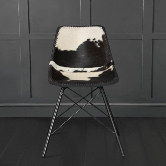 ROAD HOUSE CHAIR WITH BLACK & WHITE COW HIDE SEAT AND BLACK CROSS LEG