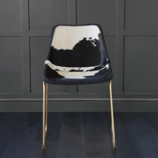 DELUXE ROAD HOUSE DINING CHAIR, BLACK & WHITE COW HIDE SEAT – GOLD BASE