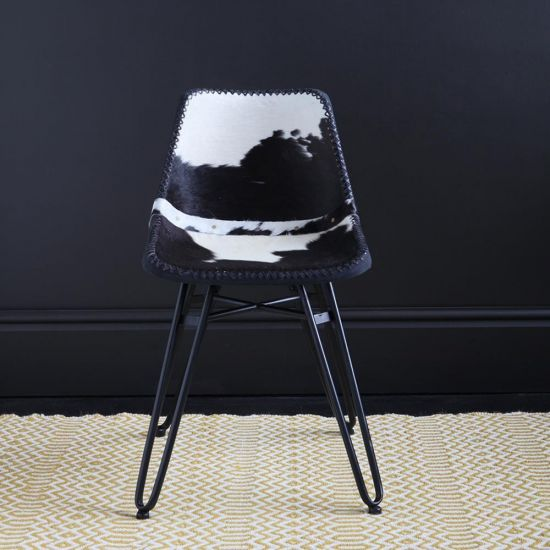 HAIRPIN DINING CHAIR WITH BLACK & WHITE COW HIDE  ROAD HOUSE SEAT AND BLACK BASE