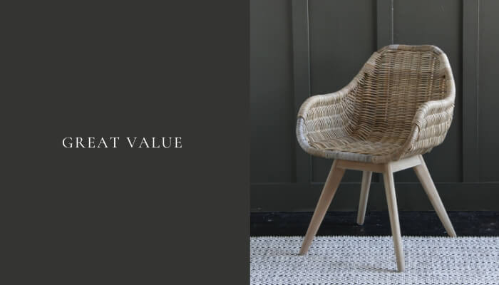 Rattan dining chair with arms from Where Saints Go